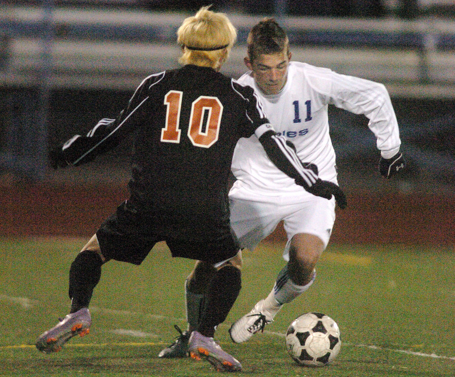 Broomfield's Trevor Sackmann fights to control the ball with Lewis-Palmer's Michael Hopson during the first state playoff game on Wednesday at Elizabeth Kennedy Staduim.<br /> October 27, 2010<br /> staff photo/David R. Jennings