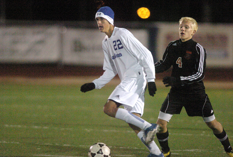 Broomfield's Colton Lamb fights takes the ball downfield past Lewis-Palmer's Casey O'Connor during the first state playoff game on Wednesday at Elizabeth Kennedy Staduim.<br /> October 27, 2010<br /> staff photo/David R. Jennings