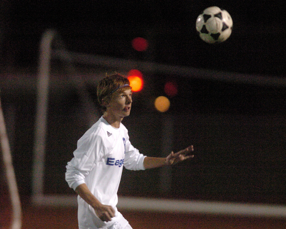 Broomfield's Austin Reece keeps his eyes on the ball during play against Lewis-Palmer in the first state playoff game on Wednesday at Elizabeth Kennedy Staduim.<br /> October 27, 2010<br /> staff photo/David R. Jennings