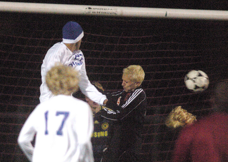 Broomfield's Colton Lamb watches in the air as the ball goes into  Lewis-Palmer's goal during the first state playoff game on Wednesday at Elizabeth Kennedy Staduim.<br /> October 27, 2010<br /> staff photo/David R. Jennings