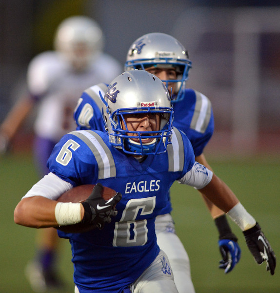 Broomfield's Gian Panicucci carries the ball downfield against Littleton during Friday's Homecoming game at Elizabeth Kennedy Stadium.<br /> September 20, 2012<br /> staff photo/ David R. Jennings