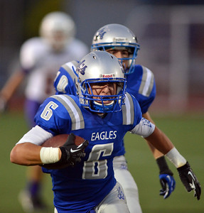 Broomfield's Gian Panicucci carries the ball downfield against Littleton during Friday's Homecoming game at Elizabeth Kennedy Stadium. September 20, 2012 staff photo/ David R. Jennings