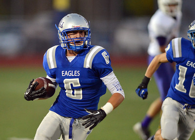 Broomfield's Gian Panicucci runs the ball downfield against Littleton during Friday's Homecoming game at Elizabeth Kennedy Stadium. September 20, 2012 staff photo/ David R. Jennings