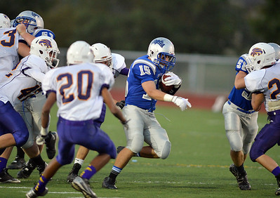 Broomfield's Conner Eakes runs the ball against Littleton during Friday's Homecoming game at Elizabeth Kennedy Stadium. September 20, 2012 staff photo/ David R. Jennings