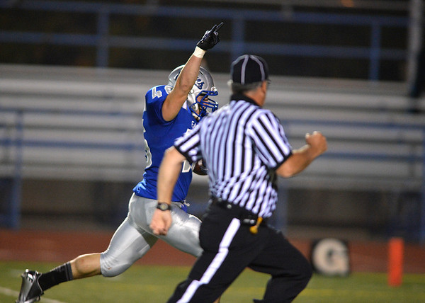 Broomfield's D. J. Zissimos runs to the end zone to score  against Littleton during Friday's Homecoming game at Elizabeth Kennedy Stadium..<br /> September 20, 2012<br /> staff photo/ David R. Jennings