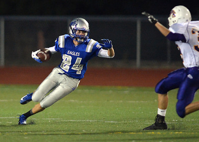 Broomfield's Riley Derus returns a kick off from Littleton during Friday's Homecoming game at Elizabeth Kennedy Stadium.. September 20, 2012 staff photo/ David R. Jennings