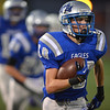 Broomfield's Dylan Plane carries the ball against Littleton during Friday's Homecoming game at Elizabeth Kennedy Stadium..<br /> September 20, 2012<br /> staff photo/ David R. Jennings