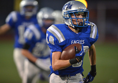 Broomfield's Dylan Plane carries the ball against Littleton during Friday's Homecoming game at Elizabeth Kennedy Stadium.. September 20, 2012 staff photo/ David R. Jennings
