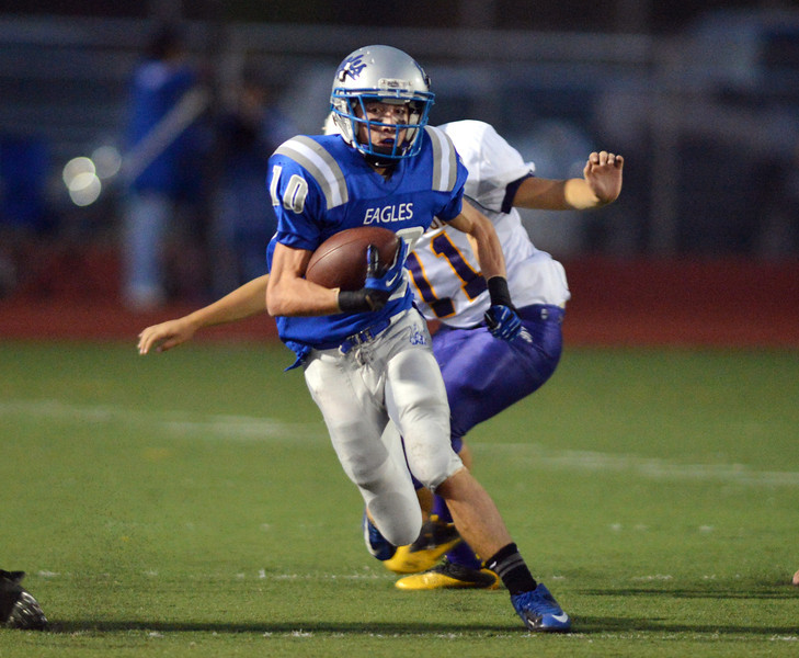 Broomfield's Dylan Plane carries the ball downfield escaping a tackle by Littleton during Friday's Homecoming game at Elizabeth Kennedy Stadium..<br /> September 20, 2012<br /> staff photo/ David R. Jennings
