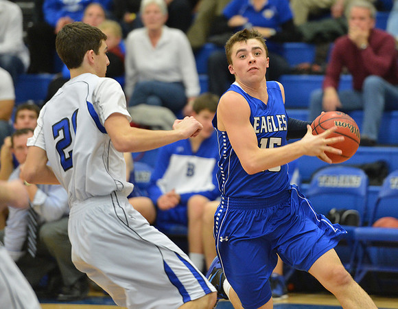 Broomfield's Evan Kihn goes to the basket against Longmont's Austin Kemp during Friday's game at Longmont High.<br /> February 8, 2013<br /> staff photo/ David R. Jennings