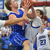Broomfield's Chad Jukkala goes to the basket against Longmont's Austin Kemp during Friday's game at Longmont High.<br /> February 8, 2013<br /> staff photo/ David R. Jennings