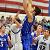 Broomfield's Alec McLain shoots to the basket over Longmont's during Friday's game at Longmont High.<br /> February 8, 2013<br /> staff photo/ David R. Jennings