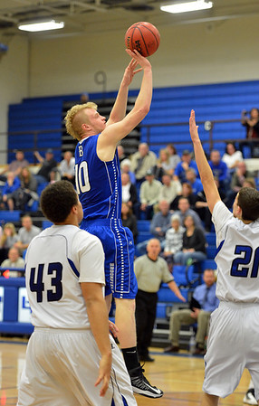 Broomfield's Dan Perse shoots to the basket  against Longmont's Marcus Johnson and Austin Kemp during Friday's game at Longmont High.<br /> February 8, 2013<br /> staff photo/ David R. Jennings