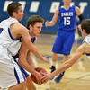 Broomfield's Spenser Reeb gets boxed in by  Longmont's Felipe Alaniz and Eli Sullivan during Friday's game at Longmont High.<br /> February 8, 2013<br /> staff photo/ David R. Jennings