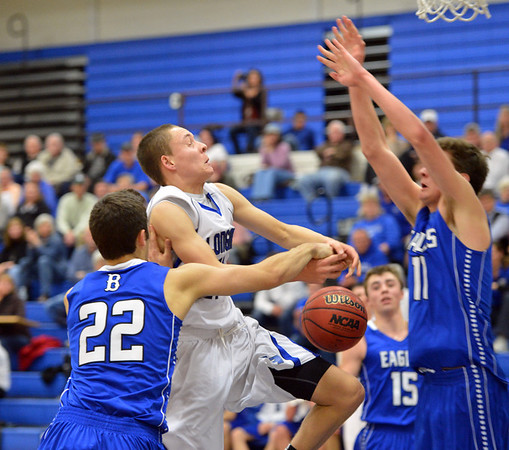 Longmont's RJ Donaldson goes to the basket against Broomfield's Alec McLain during Friday's game at Longmont High.<br /> February 8, 2013<br /> staff photo/ David R. Jennings