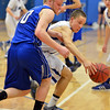 Longmont's RJ Donaldson retrieves a loose ball away from Broomfield's Dan Perse during Friday's game at Longmont High.<br /> February 8, 2013<br /> staff photo/ David R. Jennings