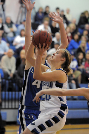 Broomfield's Meagan Prins goes to the basket against  Longmont's Megan Carpenter during Friday's game at Broomfield. <br /> <br /> January 14, 2011<br /> staff photo/David R. Jennings