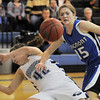 Broomfield's Stacie Hull collides with Longmont's Tambre Haddock during Friday's game at Broomfield. <br /> January 14, 2011<br /> staff photo/David R. Jennings