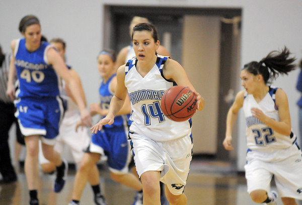 Broomfield's Katie Nehf drives the ball down court to the basket against Longmont during Friday's game at Broomfield. <br /> <br /> January 14, 2011<br /> staff photo/David R. Jennings