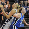 Broomfield's Bre Burgesser goes back to back against Longmont's Tambre Haddock for a rebound during Friday's game at Broomfield. <br /> <br /> January 14, 2011<br /> staff photo/David R. Jennings