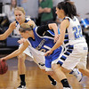 Longmont's Amber Thornholt tries to get past Broomfield's Morgan Rynearson, left, and Brittney Zec during Friday's game at Broomfield. <br /> January 14, 2011<br /> staff photo/David R. Jennings