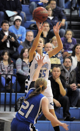 Broomfield's Katie Croell shoots to the basket over Longmont's Amber Thornholt during Friday's game at Broomfield. <br /> January 14, 2011<br /> staff photo/David R. Jennings