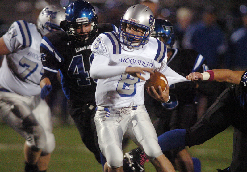 Broomfield's quarterback Aric Kaiser keeps the ball running against Longmont during Friday's game at Everly-Montgomery Field in Longmont.<br /> <br /> October 22, 2010<br /> staff photo/David R. Jennings