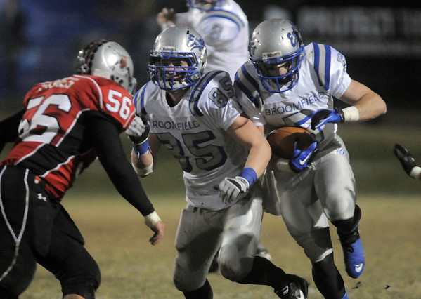 Broomfield's Dan Geubelle runs the ball downfield while Kristian Niemi blocks Loveland's Connor Shores during Friday's game at Ray Patterson Stadium in Loveland.<br /> November 19, 2010<br /> staff photo/David R. Jennings