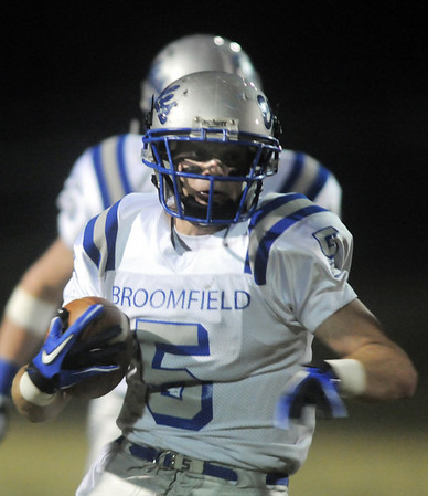 Broomfield's Dan Geubelle runs the ball downfield against Loveland during Friday's game at Ray Patterson Stadium in Loveland.<br /> November 19, 2010<br /> staff photo/David R. Jennings