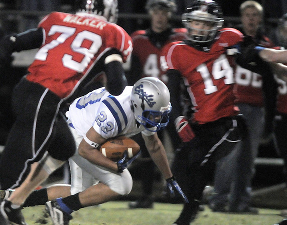Broomfield's Josh Fraire carries the ball against Loveland during Friday's game at Ray Patterson Stadium in Loveland.<br /> November 19, 2010<br /> staff photo/David R. Jennings