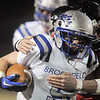 Broomfield's Dan Geubelle runs the ball downfield breaking a tackle by a Loveland player during Friday's game at Ray Patterson Stadium in Loveland.<br /> November 19, 2010<br /> staff photo/David R. Jennings
