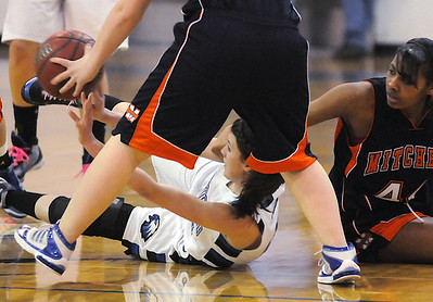 Broomfield's Autumn Chase tries to pass the ball, while on the floor, past Mitchell players during Friday's state 4A playoff game at Broomfield.  February 26, 2010 Staff photo/David R. Jennings