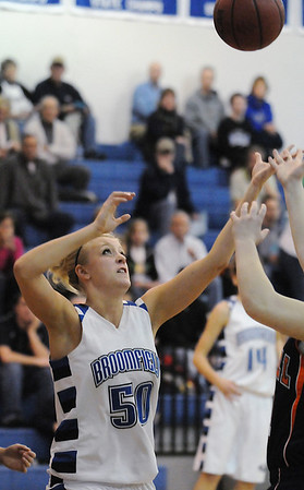 Broomfield's Bre Burgesser reaches to rebound the ball against Mitchell during Friday's state 4A playoff game at Broomfield.<br /> <br /> February 26, 2010<br /> Staff photo/David R. Jennings