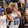 Broomfield's Bre Burgeser passes the ball away from Mitchell's xxx during Friday's state 4A playoff game at Broomfield.<br /> <br /> February 26, 2010<br /> Staff photo/David R. Jennings