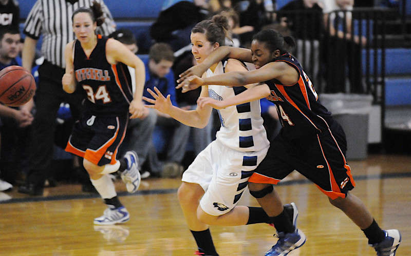 Broomfield's Katie Nehf fights for possession of a loose  ball with Mitchell's Samaria Buice during Friday's state 4A playoff game at Broomfield.<br /> <br /> February 26, 2010<br /> Staff photo/David R. Jennings