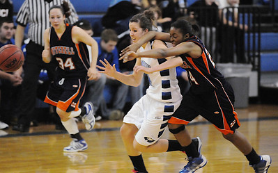 Broomfield's Katie Nehf fights for possession of a loose  ball with Mitchell's Samaria Buice during Friday's state 4A playoff game at Broomfield.  February 26, 2010 Staff photo/David R. Jennings