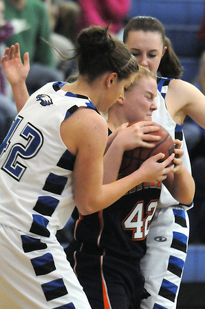 Broomfield's Renae Waters fights for possession of the ball with Mitchell's Claudia Margiotta during Friday's state 4A playoff game at Broomfield.<br /> <br /> February 26, 2010<br /> Staff photo/David R. Jennings