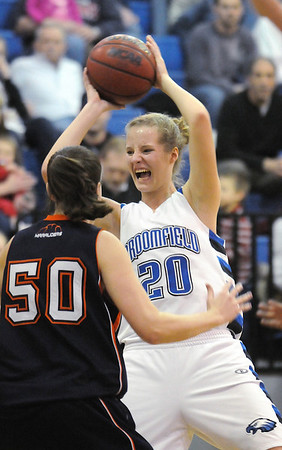 Broomfield's Meagan Prinsrebunds the ball against Mitchell's Alyssa Penzes during Friday's state 4A playoff game at Broomfield.<br /> <br /> February 26, 2010<br /> Staff photo/David R. Jennings