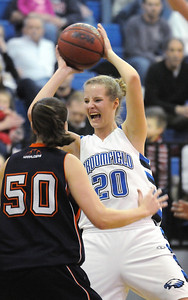 Broomfield's Meagan Prinsrebunds the ball against Mitchell's Alyssa Penzes during Friday's state 4A playoff game at Broomfield.  February 26, 2010 Staff photo/David R. Jennings