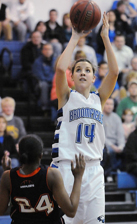 Broomfield's Katie Nehf goes to the basket against Mitchell's Samaria Buice during Friday's state 4A playoff game at Broomfield.<br /> <br /> February 26, 2010<br /> Staff photo/David R. Jennings