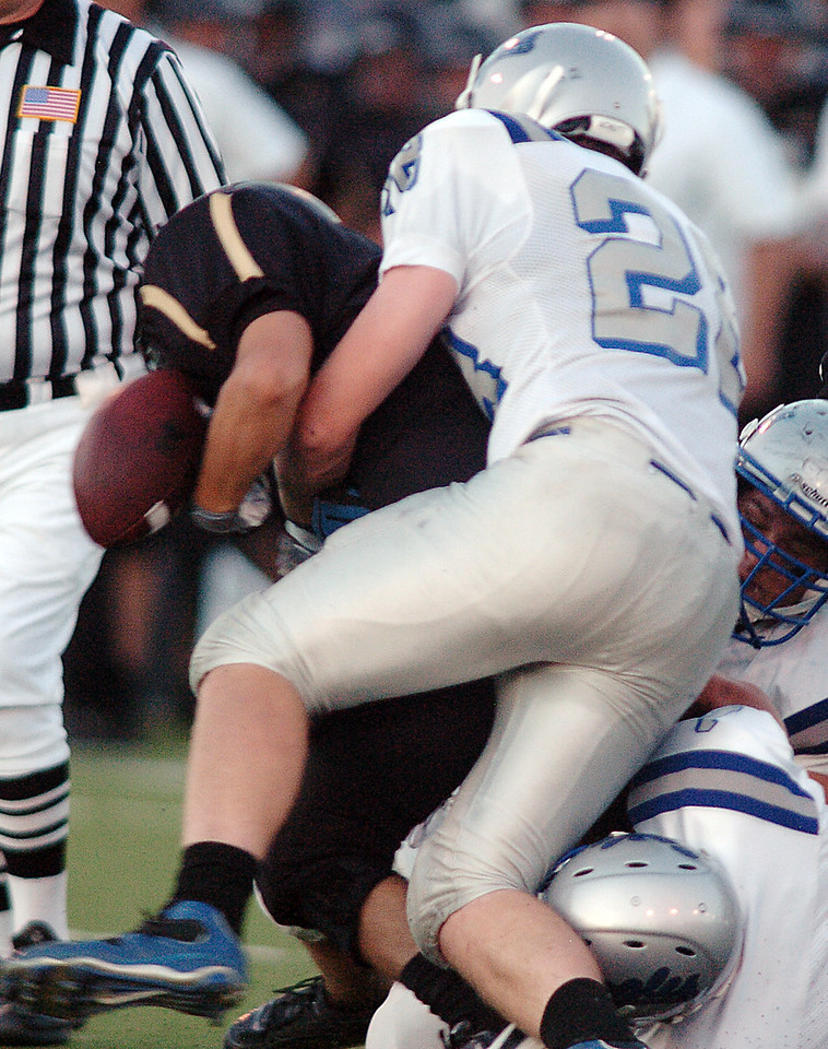 Andrew McLean, right, Broomfield, causes Alex Blazon, Monarch, to fumble the ball which was recovered by the Eagles during Friday's game at Centaurus High.  <br /> <br /> September 3, 2010<br /> staff photo/David R. Jennings