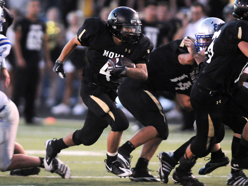 Monarch's Alex Blazon runs for a gain in yardage against Broomfield during Friday's game at Centaurus High.  <br /> <br /> September 3, 2010<br /> staff photo/David R. Jennings