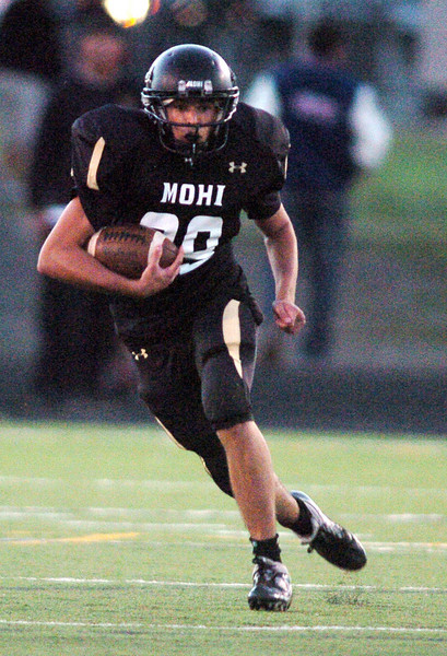 Mike Buch, Monarch, runs the ball downfield against Broomfield during Friday's game at Centaurus High.  <br /> <br /> September 3, 2010<br /> staff photo/David R. Jennings