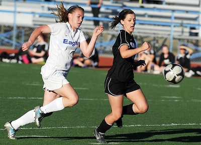 Broomfield's Katie Forsee chases after the ball against Mountain View's Kelli Hlushak during Friday's game at Elizabeth Kennedy Stadium. March 23, 2012  staff photo/ David R. Jennings