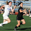 Broomfield's Katie Forsee chases after the ball against Mountain View's Kelli Hlushak during Friday's game at Elizabeth Kennedy Stadium.<br /> March 23, 2012 <br /> staff photo/ David R. Jennings