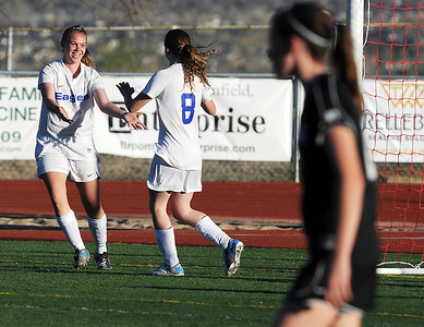 Broomfield's Katie Forsee, left, celebrates the goal by Kristin Snyder against Mountain View during Friday's game at Elizabeth Kennedy Stadium. March 23, 2012  staff photo/ David R. Jennings