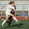 Broomfield's Katie Forsee kicks the ball past Mountain View's Paulina  Barraza during Friday's game at Elizabeth Kennedy Stadium.<br /> March 23, 2012 <br /> staff photo/ David R. Jennings