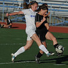 Broomfield's Katie Forsee fights for possession of the ball with Mountain View's Kelli Hlushak during Friday's game at Elizabeth Kennedy Stadium.<br /> March 23, 2012 <br /> staff photo/ David R. Jennings