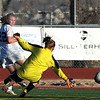 Broomfield's Katie Forsee kicks the ball past Mountain View's goalie Shilee Calhoun to set up a goal during Friday's game at Elizabeth Kennedy Stadium.<br /> March 23, 2012 <br /> staff photo/ David R. Jennings