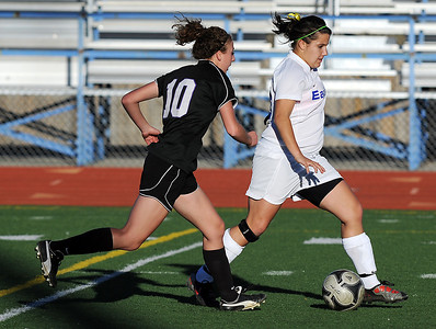 Broomfield's Kerri Marquardt keeps the ball ahead of  Mountain View's MaKenzie Ross during Friday's game at Elizabeth Kennedy Stadium. March 23, 2012  staff photo/ David R. Jennings
